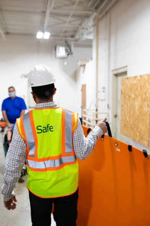 Safety consultant with high vis vest
